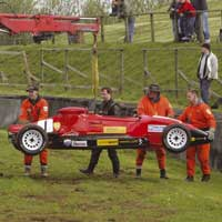 marshals removing race car