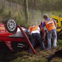 marshals working on rally car